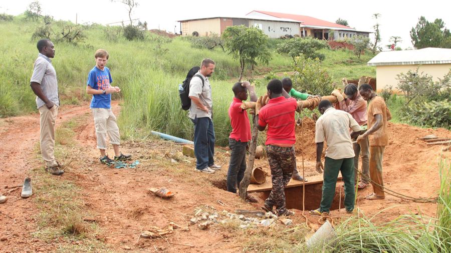 Team digging a hand dug well